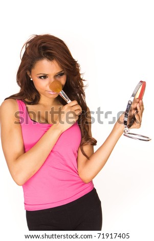 picture of lovely woman with brush and mirror preparing make-up