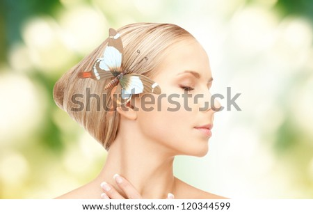 picture of lovely woman with butterflies in hair - stock photo