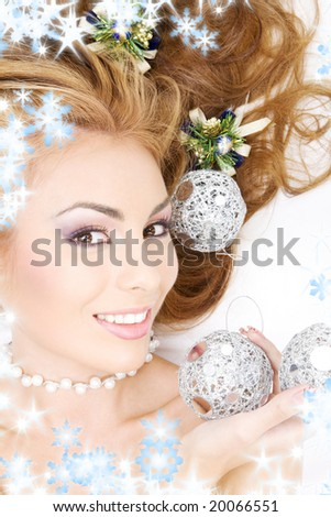 picture of lovely woman with christmas balls - stock photo