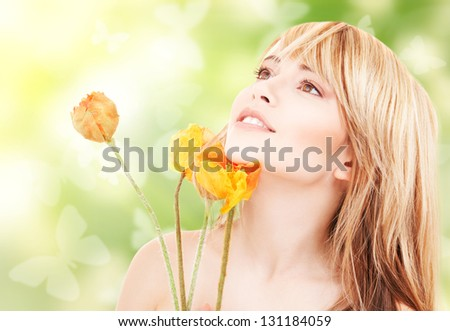 picture of lovely woman with red flowers and butterflies