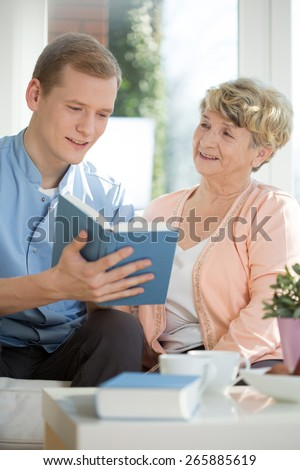 Picture of male caregiver assisting senior woman - stock photo