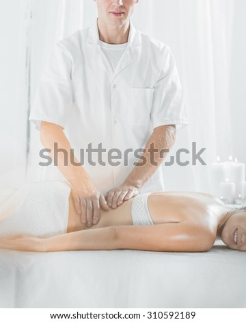 Picture of male masseur doing professional therapeutic massage  - stock photo