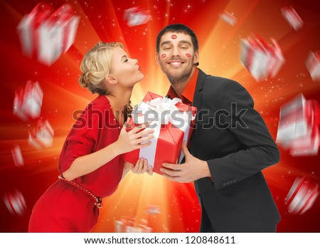 picture of man and woman with present - stock photo