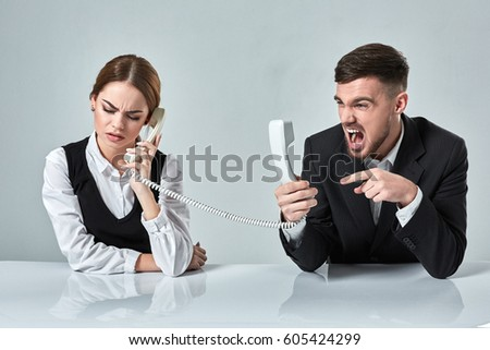 picture of man and woman with telephone at the table