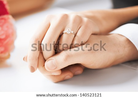 Wedding rings flowers stock images royalty free images vectors picture of man and woman with wedding ring junglespirit Images