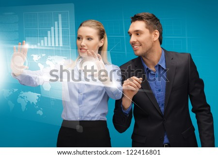 picture of man and woman working with virtual touch screens - stock photo