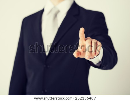 picture of man hand pointing at something - stock photo