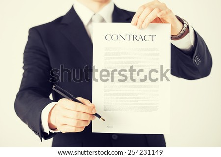 picture of man hands holding contract with random text - stock photo