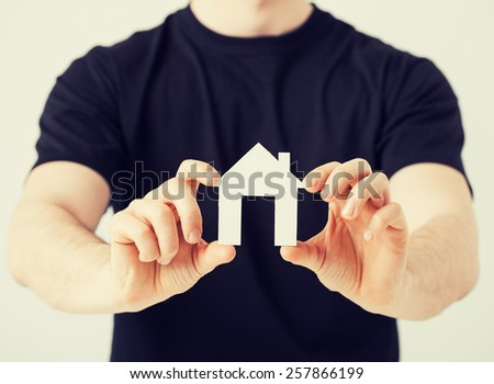 picture of man hands holding paper house - stock photo