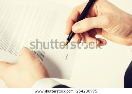 picture of man hands signing contract with random text - stock photo