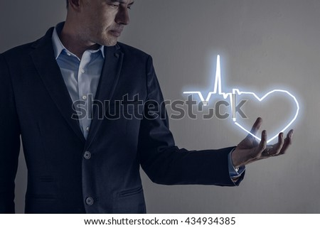 Picture of man holding a lightning heart - stock photo