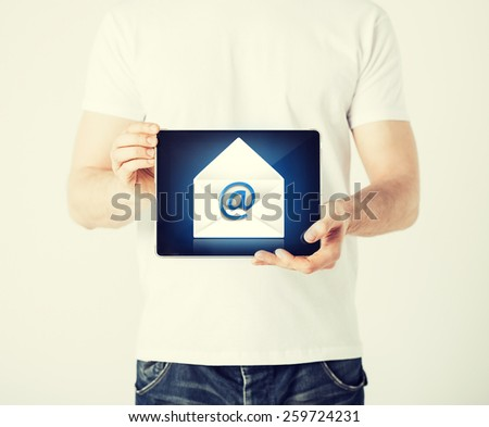 picture of man holding tablet pc with email sign - stock photo