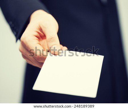 picture of man in suit holding credit card - stock photo