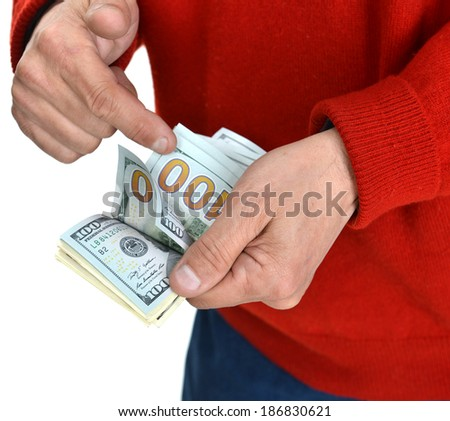 Picture of man's hands counting dollar cash money - stock photo