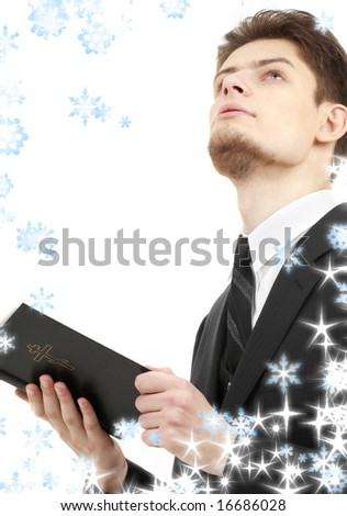 picture of man with holy bible and snowflakes - stock photo