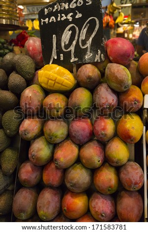 Picture of Mango Fruit in vertical form, with price label on top. Picture taken in Barcelona, Spain - stock photo