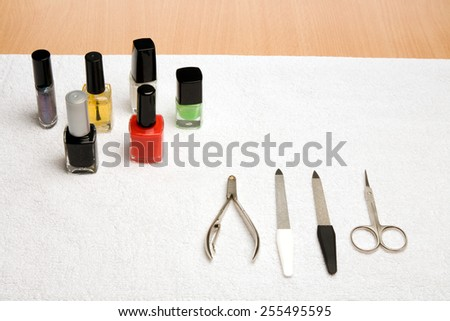Picture of manicure instruments and a lot of nail varnish - stock photo