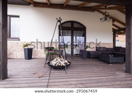 Picture of modern stylish patio with fireplace - stock photo