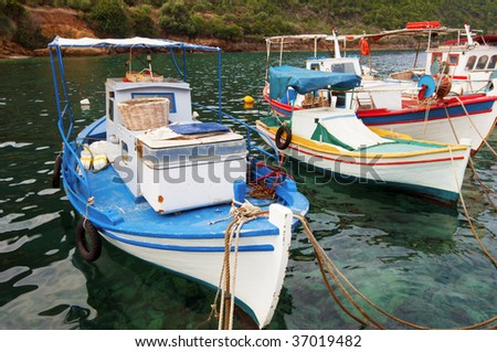 Picture of moored fishing boats in an idyllic bay