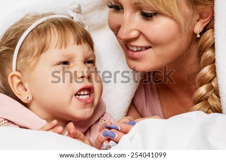 picture of mother and daughter whispering gossip