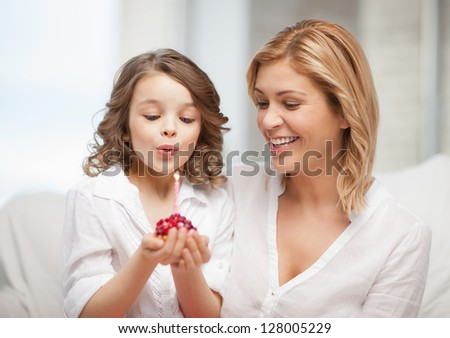 picture of mother and daughter with cupcake