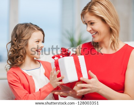 picture of mother and daughter with gift box - stock photo