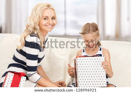picture of mother and little girl with gifts. - stock photo