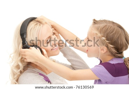 picture of mother and little girl with headphones. - stock photo
