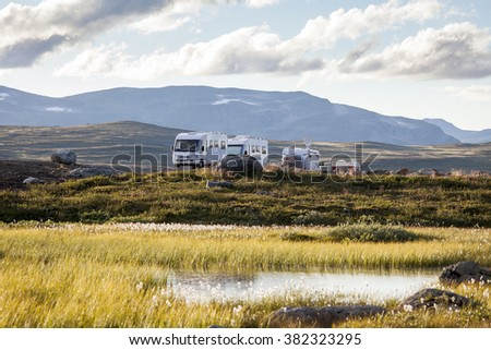 Picture of motor homes parked in the wilderness of Swedish Lapland. - stock photo