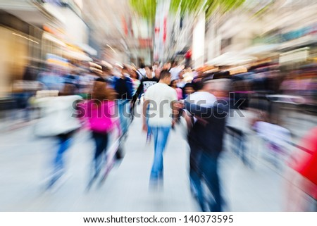 picture of moving people in the pedestrian area of the city with zoom effect - stock photo