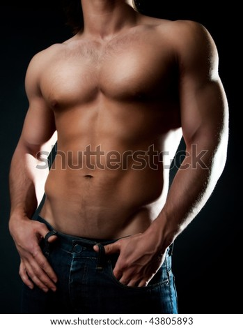 Picture of muscular males body - stock photo