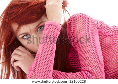picture of mysterious redhead in pink fishnet - stock photo
