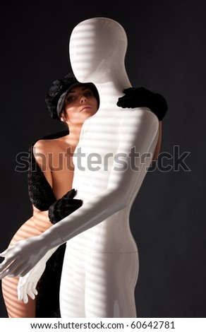 picture of naked woman with white male mannequin - stock photo