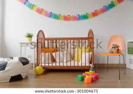 Picture of neat furnished light baby room with wall decoration - stock photo