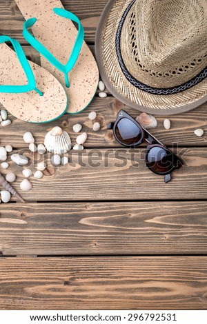 Picture of necessary summer objects necessary for vacation. Flip-flops, straw hat and sunglasses to feel comfortable during your trip. - stock photo