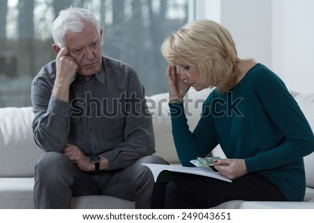 Picture of older couple troubled by financial problems - stock photo
