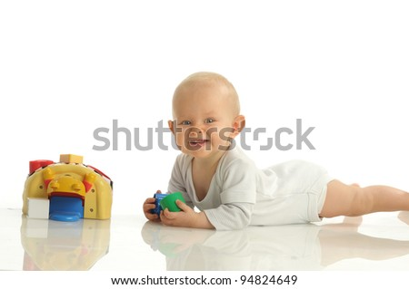 Picture of one little girl playing with toys