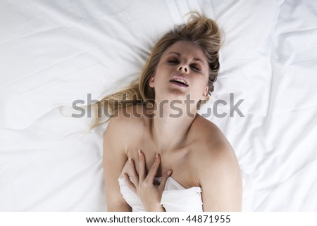 Picture of passionate naked woman on her bed - stock photo
