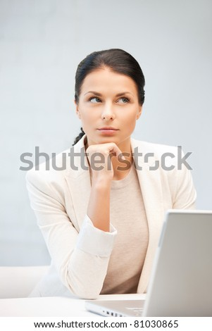 picture of pensive woman with laptop computer