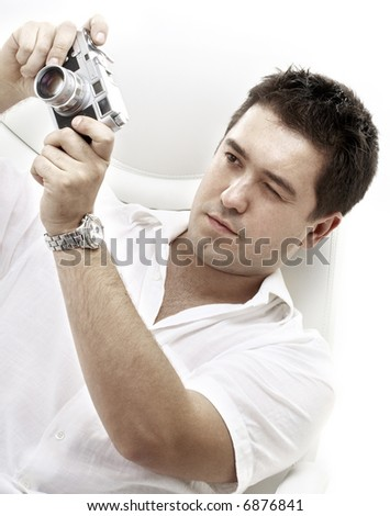 picture of photographer with old rangefinder camera - stock photo