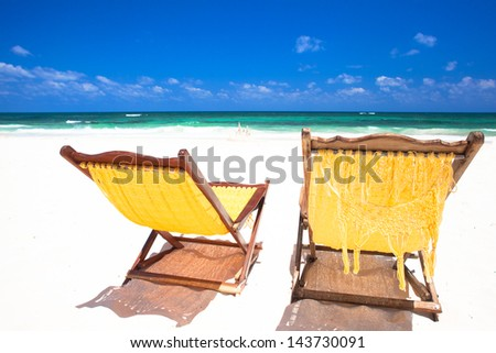 picture of pina colada and sunglasses on tropical beach - stock photo