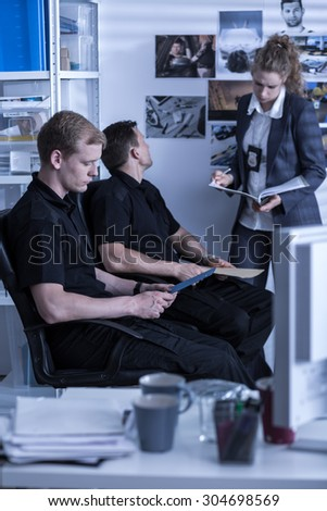 Picture of police investigation office workers during work - stock photo