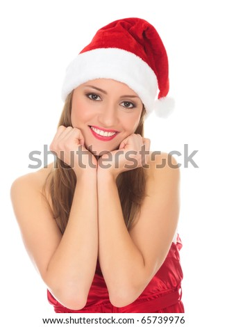 Picture of pretty christmas girl in red dress and santa hat, smiling isolated on white background - stock photo