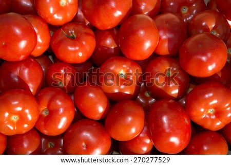 Picture of red tomatoes background. - stock photo