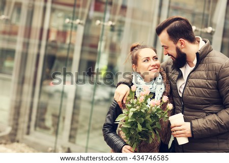 Picture of romantic couple on date with flowers