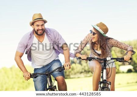 Picture of romantic couple riding bikes - stock photo