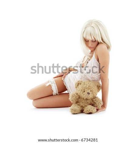 picture of sad white lingerie blond with teddy bear - stock photo