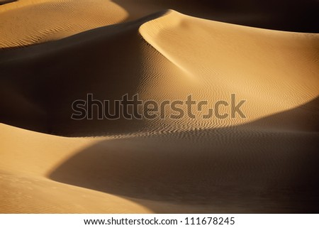 Picture of sand dunes with shadows in the Sahara desert of Morocco. - stock photo