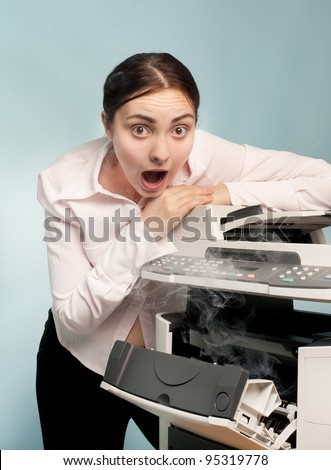 Picture of screaming businesswoman with smoking copier - stock photo