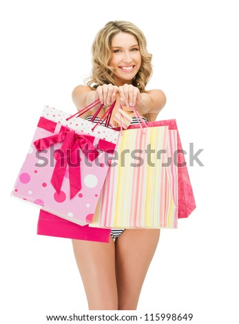 picture of seductive woman in bikini with shopping bags - stock photo